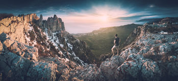 In the Crimea mountains. Instagram stylization. Man standing on a cliffs edge in the Crimea mountains. Ay-Petry mountain. Instagram stylization stock image