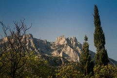 Crimea Rocky Mountain View from Vorontsov Palace Park. Panorama of Crimea rocky mountain under sunlight from Vorontsov palace park in springtime royalty free stock image