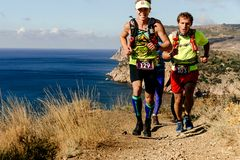 group athletes runners running trail along sea royalty free stock image