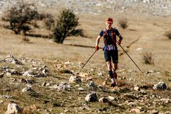 Male athlete runner with trekking poles runnning on mountain trail. Crimea, Russia - October 11, 2017: male athlete runner with trekking poles runnning on Stock Images