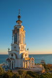 Crimea. St. Nicholas Church-lighthouse at sunset Royalty Free Stock Images