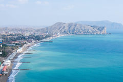 Crimea, Sudak bay. View of the city of Sudak, mountains and the Black Sea stock photography