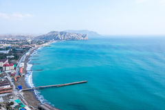 Crimea, Sudak bay. View of the city of Sudak, mountains and the Black Sea royalty free stock photography