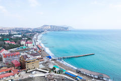 Crimea, Sudak bay. View of the city of Sudak, mountains and the Black Sea royalty free stock image