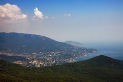 Crimea summer landscape. View on city Yalta and Black Sea coast from distance with aerial perspective Stock Images
