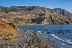 Crimea , tract Alchak - Kai. Pebble beach near Cape Meganom . Stock Photography