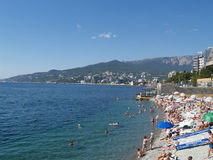 Crimea, Yalta. View of the beach and the black sea coast Stock Images