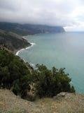 Crimean Black Sea coast near Cape Aiya on a cloudy day. Crimean coast near Balaclava, Sevastopol, Ukraine Royalty Free Stock Photos