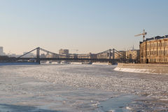 Crimean bridge over the frozen river. On a sunny day Stock Images