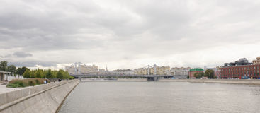 Crimean bridge. On the quays are moving pedestrians and cars Stock Images