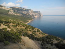 The Crimean coast. Crimean coast see beach summer sunny warm vacation holiday mountains rocks rock climbing tourism stock photography