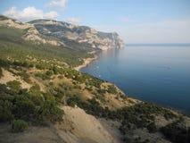 The Crimean coast. Crimean coast see beach summer sunny warm vacation holiday mountains rocks rock climbing tourism Stock Photography