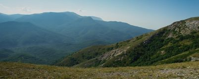 Crimean Highlands. Panorama of the Crimean Highlands. View from the plateau to wooded slopes and distant mountains stock image