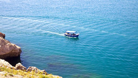 Crimean landscape. View on a swimming ship from a high mountain Stock Image