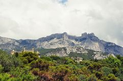 Crimean Mountains. Landscape in Crimea mountains, trees,the tip of the palace. Ukraine Stock Images