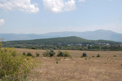 Crimean mountains. The ridge of the Crimean mountains and the valley at sunny summer midday Stock Image