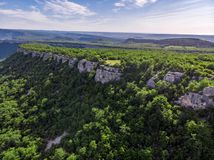 Crimean mountains in summer covered with green forest stock images
