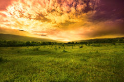 Crimean mountains sunset time. Sunset over mountains and meadows under cloudy sky stock photos