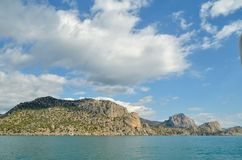Crimean sea and mountains in the summer near the town of Sudak. The beauty of the mountains and the sea fascinates Royalty Free Stock Photo