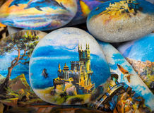 Crimean souvenir - a stone with a picture of the castle Swallow's Nest Stock Photography