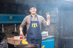 Crimean Tatar runs street food business royalty free stock images