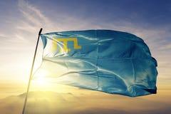Crimean Tatars Crimeans flag textile cloth fabric waving on the top sunrise mist fog. Beautiful royalty free illustration