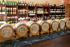 Crimean wine in barrels and bottles in shop Stock Images