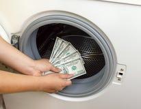 Crimen del concepto del lavadero del dólar Foto de archivo