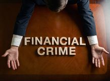 Crimen financiero de la frase y hombre devastado foto de archivo libre de regalías