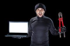 Crimes avec un ordinateur portable images stock