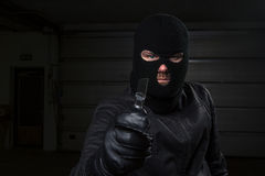 Criminal. Masked criminal holding a knife Royalty Free Stock Photo