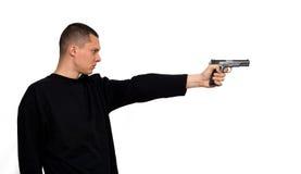 Criminal. Man with a gun isolated Stock Photos