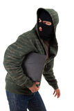 Criminal in balaclava with the laptop Stock Photos