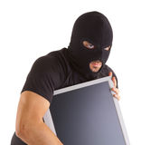 Criminal with balaclava and monitor Royalty Free Stock Photo