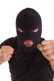 Criminal with balaclava pull any punches Stock Photo