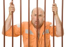 Locked Up Thief. A criminal behind bars in prison stock photos