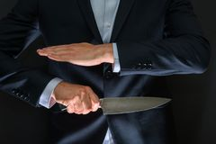 Criminal with big knife hidden. Cold weapon, burglary, homicide, murder scenery royalty free stock images