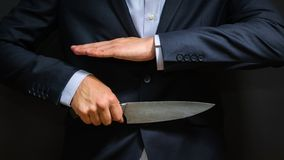 Criminal with big knife hidden. Cold weapon, burglary, homicide, murder scenery royalty free stock photos