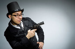 The criminal in black coat holding hadgun against Royalty Free Stock Image