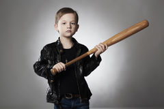 Criminal boy with baseball bat.Funny child in leather coat. Little thug Royalty Free Stock Images