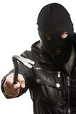 Criminal burglar man in mask holding crowbar. Crime scene - criminal thief or burglar man in balaclava or mask covering face holding crowbar in hand for break Royalty Free Stock Photography