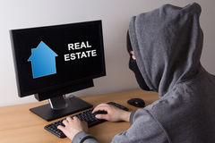 Criminal and burglary concept - thief in mask searching info abo Royalty Free Stock Photography