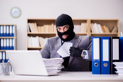 The criminal businessman with balaclava in office. Criminal businessman with balaclava in office Royalty Free Stock Image
