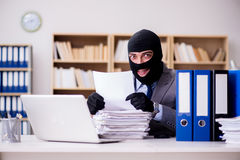 The criminal businessman with balaclava in office Stock Photography
