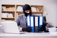 The criminal businessman with balaclava in office Royalty Free Stock Images