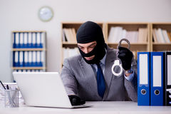The criminal businessman with balaclava in office Royalty Free Stock Photography