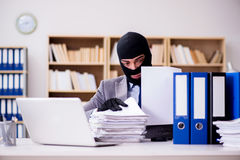 The criminal businessman with balaclava in office Royalty Free Stock Photos