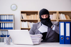 The criminal businessman with balaclava in office. Criminal businessman with balaclava in office Stock Image