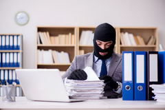 The criminal businessman with balaclava in office. Criminal businessman with balaclava in office Stock Photos
