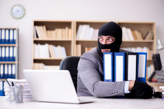 The criminal businessman wearing balaclava in office Royalty Free Stock Images